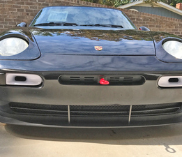 Porsche 968 splitter with vertical fence front view